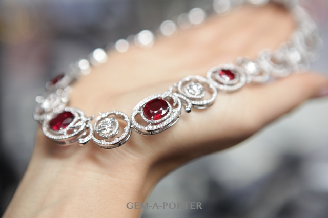 Romantic diamond swirls punctuate these grand jewels inspired by sensuous antique lace, bringing together rich red rubies with round brilliant cut-diamonds to striking effect.